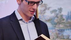 Young Attractive College Student reading book at Art Class Stock Footage