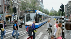 Tram stop, Red Care manifestation at the Damrak square, Amsterdam, Netherlands. Stock Footage