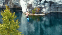 Woman Rides Zipline in Ruskeala Marble Canyon - stock footage