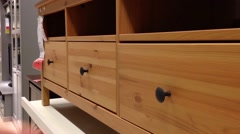 A hand opens a drawer in cabinet - stock footage
