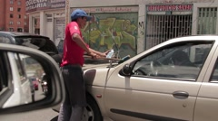 Window Washer at Traffic Light - stock footage
