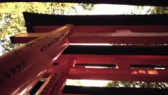 Looking up at the famous orange gates at Fushimi Inari Shinto shrine in Kyoto, - stock footage