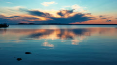 Tranquil Sunrise on Lake Landscape Stock Footage