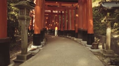 POV slomo walk through the famous orange gates at Fushimi Inari shrine in Kyoto - stock footage