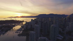 4K aerial backward shot of Vancouver Skyline at sunset Arkistovideo