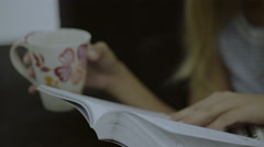 Female reading and drinking cofee Stock Footage