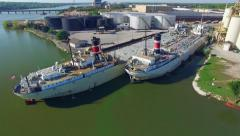 Two Industrial Freighter Ships in Dock Stock Footage