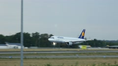 Lufthansa Airbus 320 D-AIQU landing on runway 25R Stock Footage