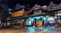 Time-lapse of people surrounding the ancient Japanese bathhouse Dogo Onsen Footage