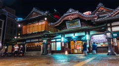 Time-lapse of people surrounding the ancient Japanese bathhouse Dogo Onsen Stock Footage
