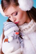 Cute woman with little snowman. Winter fashion. Stock Photos