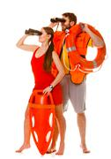 Stock Photo of Lifeguards with rescue ring buoy and life vest.