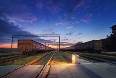 Cargo train platform at night. Railroad in Ukraine. Railway station - stock photo