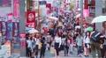 People shop along on Takeshita Street in Harajuku, Tokyo, Japan Footage