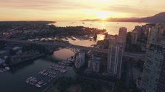 4K Aerial drone vertical shot of Vancouver Skyline at sunset Stock Footage