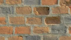 Brick wall details 4K 2160p UHD panning video - Bricks in the wall lighted 4k Stock Footage
