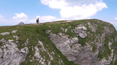 Aerial - Hiker reaching the summit Stock Footage