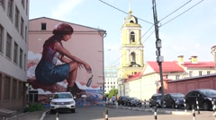 """The Messenger"" by street artist Fintan Magee, Moscow, Russia. - stock footage"
