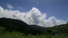 Clouds, alpine meadow,mountains in Ili River Valley Stock Footage