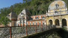 Bridge over  river Cerna   of spa resort Herculane located in  western Romani Stock Footage