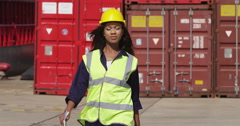 Portrait of a dock worker at an industrial harbor walking towards the camera. Stock Footage