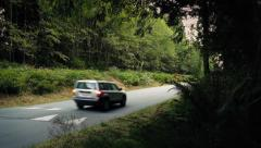 4x4 Car Drives Past Dense Forest Stock Footage