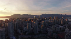 4K aerial vertical pan shot of Vancouver Skyline at sunset Stock Footage