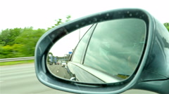 Automotive: Highway view on side mirror of a car Stock Footage