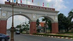 A view at an arch with the sign that reads: the City of Ba Ria Stock Footage