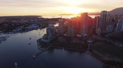 4K dramatic aerial shot of Vancouver Skyline at sunset Arkistovideo