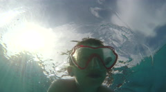Boy swimming with goggles Stock Footage