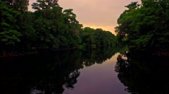 Tropical forest river at sunset on a quiet evening - stock footage