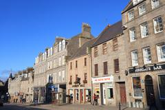 Stock Photo of Granite townhouses and shops on Schoolhill Street in Aberdeen