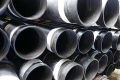 Stack of flush joint connection oil well casing (pin end) bundles . Stock Photos