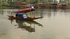 Local people use a small boat for transportation in the lake of Srinagar, India - stock footage