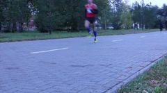 Participant of the marathon run to the finish line Stock Footage