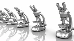 Modern scientific microscopes isolated on white Stock Footage