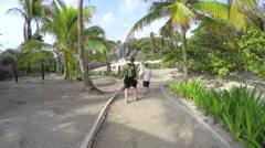 Family walking through gorgeous Tulum Mexico Ruins Arkistovideo