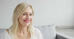 Pretty Middle Aged Woman Smiles at the Camera - stock footage