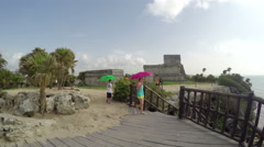 Pan across cliff of Tulum Ruins - looking out towards ocean Stock Footage