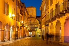Street of Alba in evening. Stock Photos
