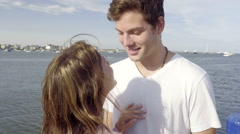 Cute Couple Have Intimate Conversation On A Dock - stock footage