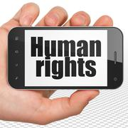 Stock Illustration of Politics concept: Hand Holding Smartphone with Human Rights on display