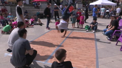 Breakdancing and DJ booth at town square festival Stock Footage