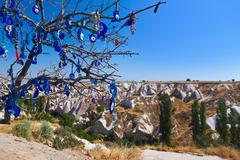 Tree and evil eye amulet in Cappadocia Turkey Stock Photos