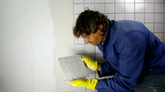 Tiler at work in a kitchen Stock Footage