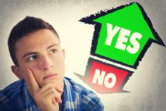 Teenage boy thinking what to choose between YES and NO - stock photo