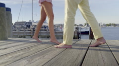 Young Couple Dance Barefoot On A Dock In Summer (View Of Their Legs/Feet) Stock Footage