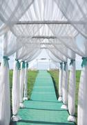 Wedding ceremony, arch from the tent and the path leading into the distance,  Stock Photos