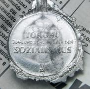 Stock Photo of Cast billet medals